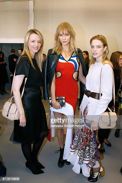 Louis Vuitton's executive vice president Delphine Arnault models Karlie Kloss and Natalia Vodianova attend the Louis Vuitton show as part of the...