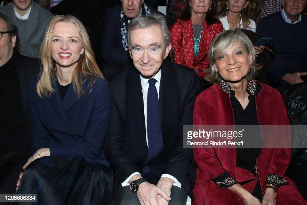 Louis Vuitton's executive vice president Delphine Arnault Owner of LVMH Luxury Group Bernard Arnault and his wife Helene Arnault attend the Dior show...