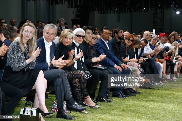 Louis Vuitton's executive vice president Delphine Arnault Owner of LVMH Luxury Group Bernard Arnault his wife Helene MercierArnault Stylist Karl...
