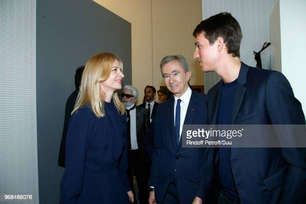 Louis Vuitton's executive vice president Delphine Arnault Owner of LVMH Luxury Group Bernard Arnault and CEO of Rimowa Alexandre Arnault attend the...