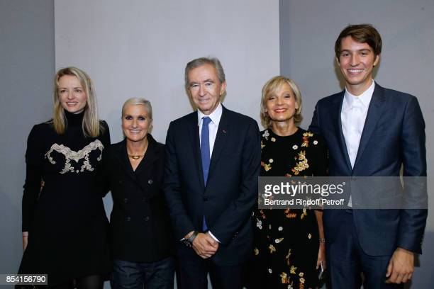 Louis Vuitton's executive vice president Delphine Arnault Stylist Maria Grazia Chiuri Owner of LVMH Luxury Group Bernard Arnault his wife Helene...