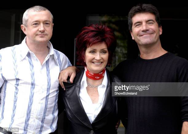 Louis Walsh Sharon Osbourne and Simon Cowell pose for photos after auditioning hundreds of hopeful musicians for their new TV show X Factor at Jury's...