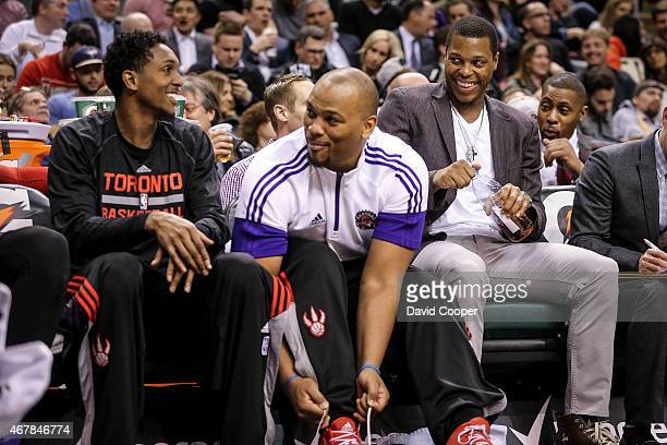 TORONTO ON MARCH 27 Louis Williams Chuck Hayes qnd Kyle Lowry of the Toronto Raptors have a laugh together on the bench during the game between the...
