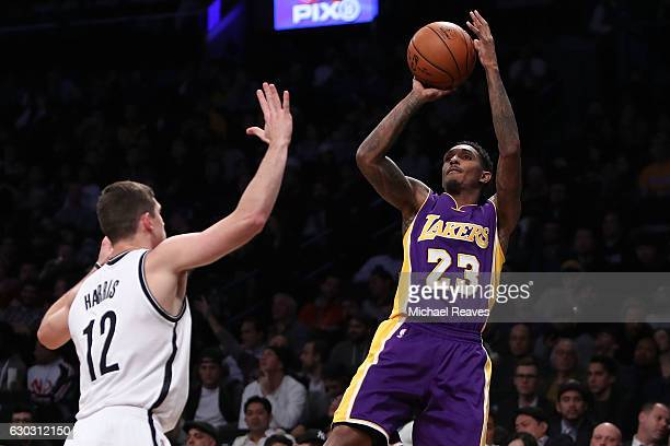 Louis Williams of the Los Angeles Lakers shoots a jumper over Joe Harris of the Brooklyn Nets in the second half at Barclays Center on December 14...
