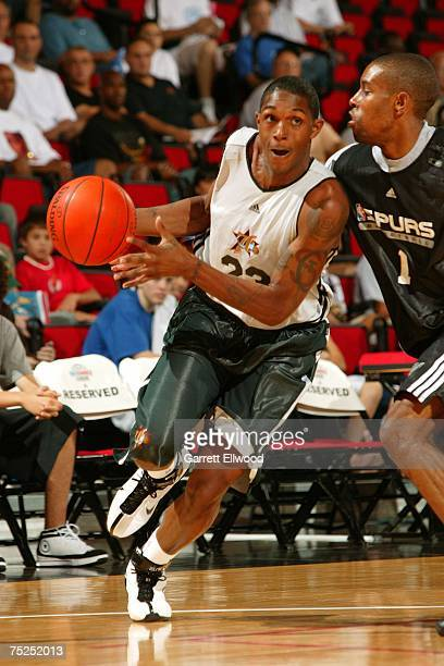 Louis Williams of the Philadelphia 76ers drives to the hoop against C.J. Watson of the San Antonio Spurs on July 6, 2007 at the Cox Pavilion in Las...