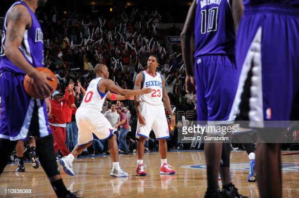 Louis Williams of the Philadelphia 76ers reacts after hitting a buzzer beater three to tie and force overtime against the Sacramento Kings during the...