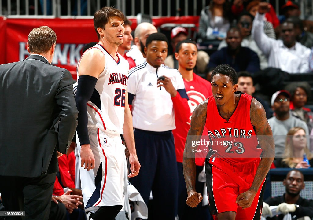 Louis Williams #23 of the Toronto Raptors reacts after hitting a three-point basket against Kyle Korver #26 of the Atlanta Hawks at Philips Arena on February 20, 2015 in Atlanta, Georgia.