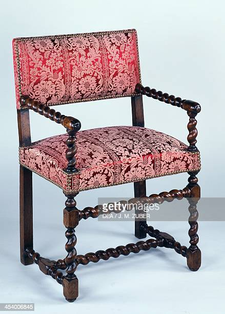 Louis XIII style walnut chair with twist turned arms and legs France 17th century