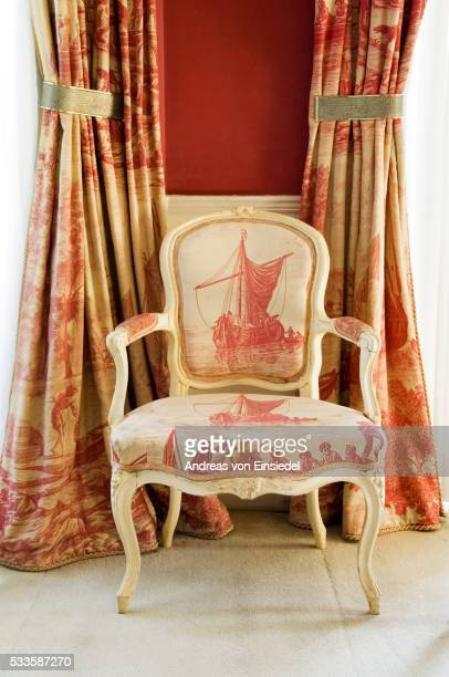 A Louis XV chair upholstered in toile de Jouy in the Octagon Room at Plas Newydd, on the Isle of Ang