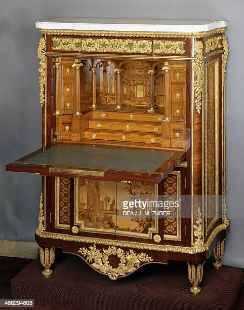 Louis XVI style Second Empire amaranth and sycamore secretary with veined white marble top open drop leaf France second half 19th century