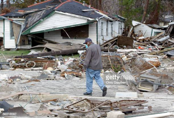 Louis Young walks past his house that has moved more than 150 yards away from it's original foundation as residents return on a 'look and leave'...