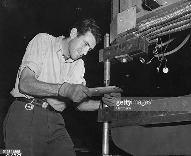 Louis Zamperini former University of Southern California track man and one of the great milers is now working as a spot welder in the experimental of...