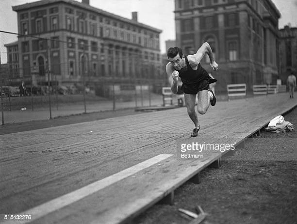 Louis Zamperini University of Southern California track star runs with old Father Time as an opponent during workout at South Field Columbia...
