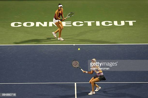 Louisa Chirico and Alison Riske of the United States compete during their doubles match against Sania Mirza of India and Monica Niculescu of Romania...