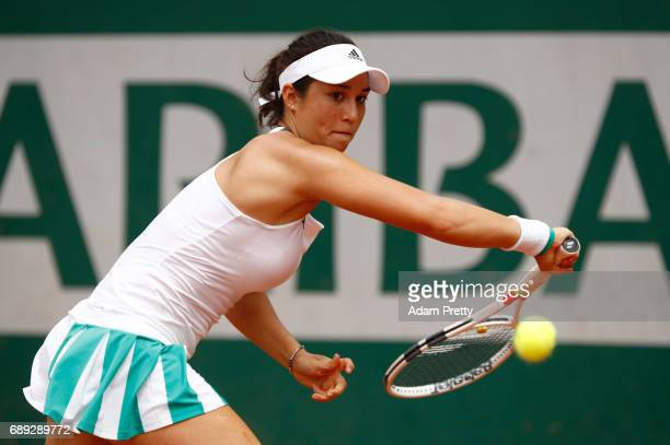 Louisa Chirico of The United States hits a backhand during the ladies singles first round match against Jelena Ostapenko of Latvia on day one of the...