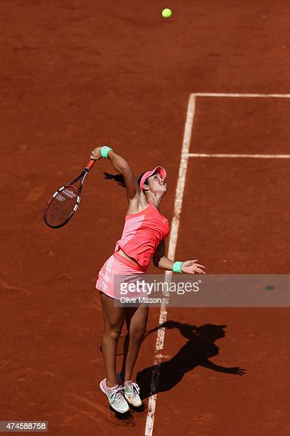 Louisa Chirico of the United States serves in her Women's Singles match against Ekaterina Makarova of Russia on day one of the 2015 French Open at...