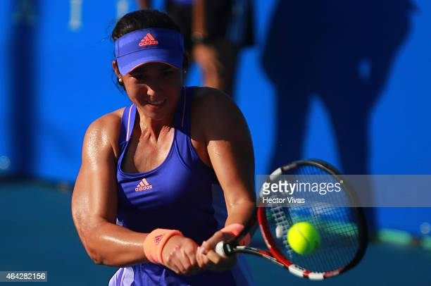 Louisa Chirico of USA returns a shot against Risa Ozaki of Japan during a female single match as part of Telcel Mexican Open 2015 at Mextenis Stadium...