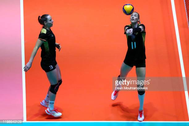 Louisa Lippmann of Germany returns the ball as Denise Hankeu looks on during the Women CEV Tokyo Volleyball European Qualification 2020 match between...