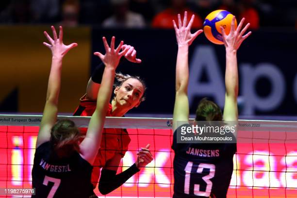 Louisa Lippmann of Germany spikes the ball against Celine Van Gestel and Marlies Janssens of Belgium during the Women CEV Tokyo Volleyball European...