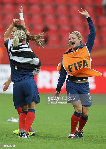 Louisa Necib Eugenie Le Sommer and Laure Boulleau of France celebrate after winning 54 after penalty shootout the FIFA Women's World Cup 2011 Quarter...