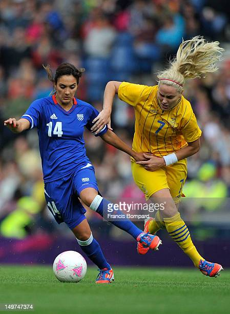Louisa Necib of France and Lisa Dahlkvist of Sweden battle for the ball during the Women's Football Quarter Final match between Sweden and France on...