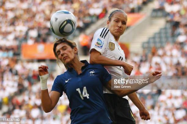 Louisa Necib of France is challenged by Babett Peter of Germany during the FIFA Women's World Cup 2011 Group A match between France and Germany at...