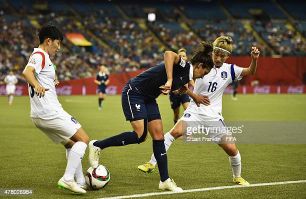 Louisa Necib of France is challenged by Yumi Kang of Korea during the FIFA Womens's World Cup round of 16 match between France and Korea at Olympic...