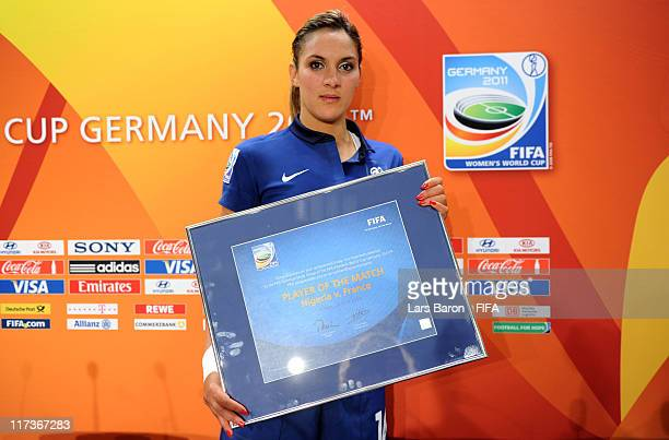 Louisa Necib of France is honored as 'Player of the match' after winning the FIFA Women's World Cup 2011 Group A match between Nigeria and France at...