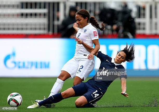 Louisa Necib of France knocks the ball away from Alex Scott of England during the FIFA Women's World Cup 2015 Group F match at Moncton Stadium on...