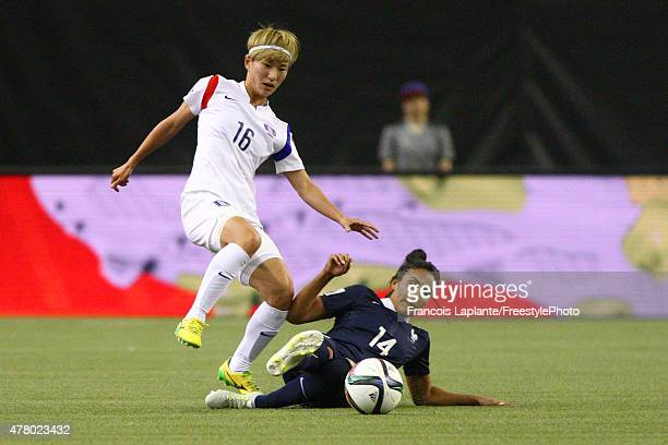 Louisa Necib of France plays the ball as she fall against Yumi Kang of Korea during the FIFA Women's World Cup Canada 2015 round of 16 match between...