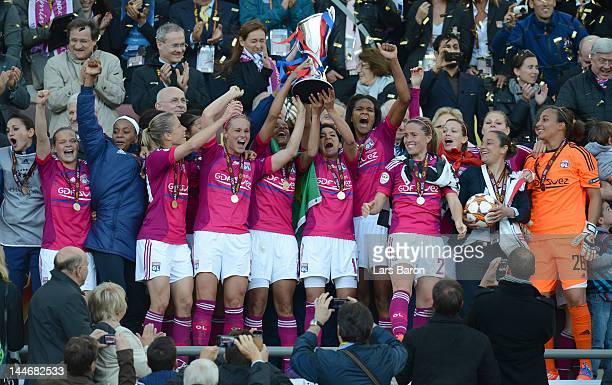 Louisa Necib of Olympique Lyonnais lifts the trophy and celebrates with team mates after winning the UEFA Women's Champions League Final at...