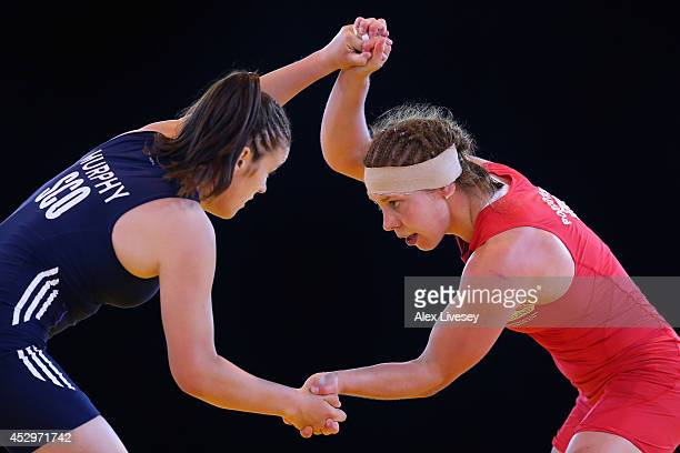 Louisa Porogovska of England and Chelsea Murphy of Scotland compete in the Quarter Final of the 55kg Women's Wrestling at Scottish Exhibition And...