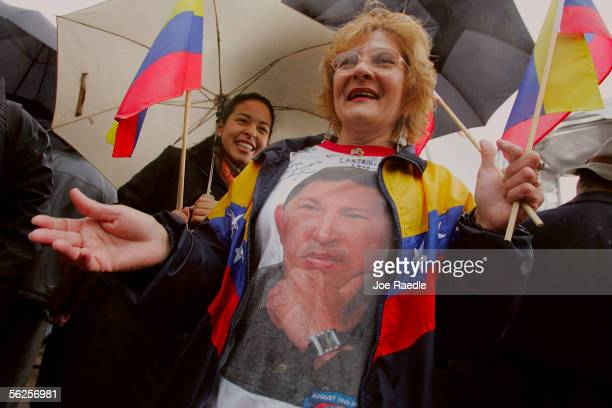 Louisa Rodriguez wears a shirt with a picture of Venezuelan president Hugo Chavez as Rep Bill Delahunt and Felix Rodriquez chief executive officer of...