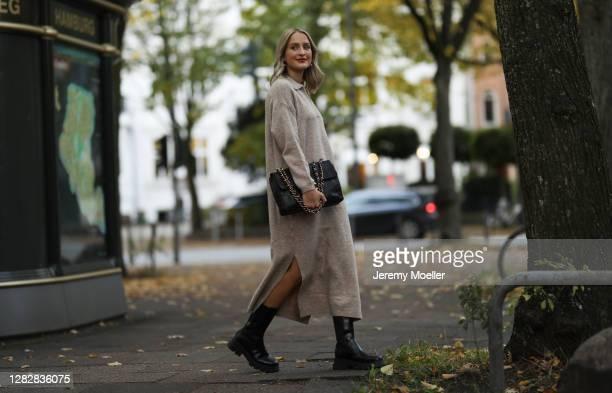 Louisa Theresa Grass wearing Mango knit dress, Nakd boots and Chanel bag on October 22, 2020 in Hamburg, Germany.
