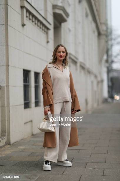 Louisa Theresa Grass wearing The Curated beige two piece, The Curated brown coat, beige Nubikk sneaker and JW Pei on February 02, 2021 in Hamburg,...