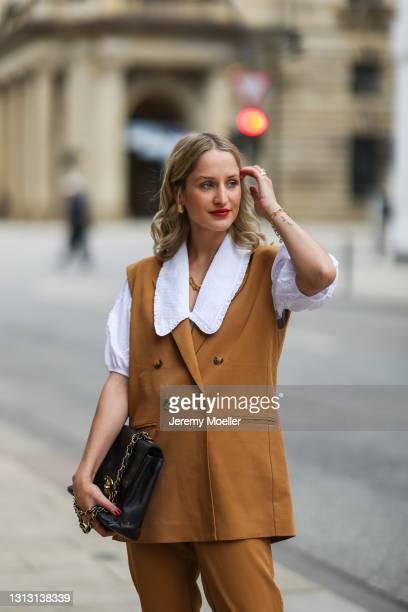 Louisa Theresa Grass wearing white Soft Rebels blouse and brown suit and Chanel leather bag on April 15, 2021 in Hamburg, Germany.