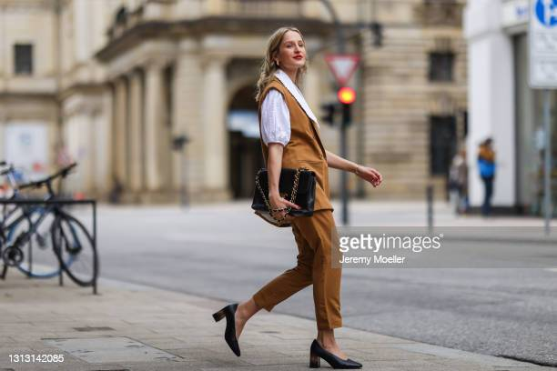 Louisa Theresa Grass wearing white Soft Rebels blouse and brown suit, Tamaris heels and Chanel leather bag on April 15, 2021 in Hamburg, Germany.