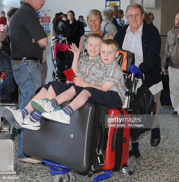 Louise and Derrick Bromley from Sutton Coldfield with their grandchildren George and Dillon arrive at Birmingham Airport after being stuck in Benidorm