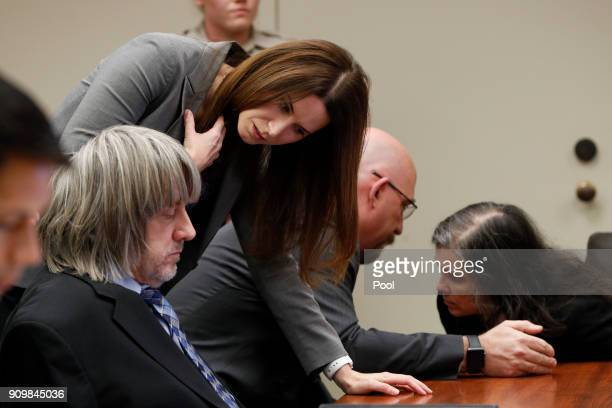 Louise Anna Turpin and David Allen Turpin accused of abusing and holding 13 of their children captive listen to attorneys Alison Lowe and Jeff Moore...