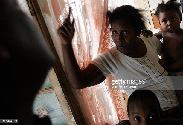 Louise Auguste shouts 17 January 2005 at her home in Port Louis Mauritius The family of 9 originally from the Chagos Archipelago now live a miserable...