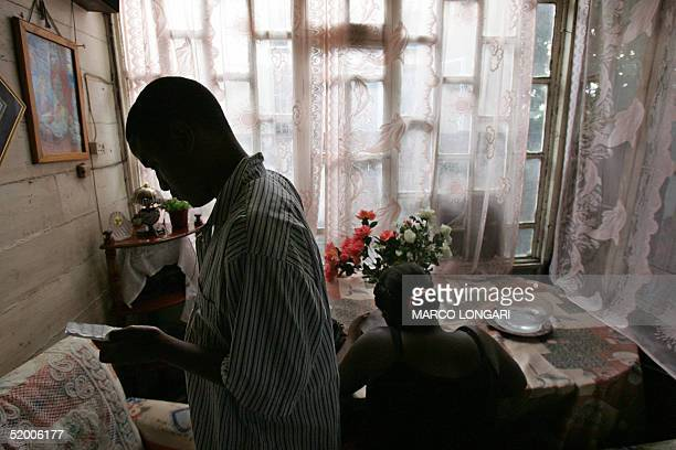 Louise Auguste sits at her table 17 January 2005 at her home in Port Louis Mauritius The family of 9 originally from the Chagos Archipelago now live...