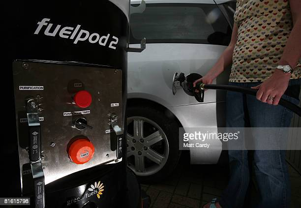 Louise Bailey goes to fill her car with biodiesel made from recycled cooking oil using a Fuelpod 2 on June 18 2008 in Stroud England Massive price...