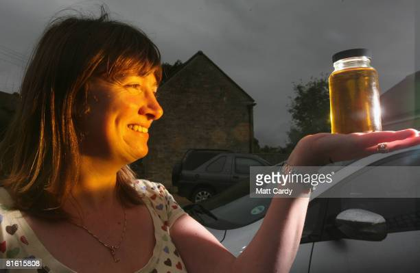 Louise Bailey poses with a sample of biodiesel made from recycled cooking oil using a Fuel Pod 2 on June 18 2008 in Stroud England Massive price...