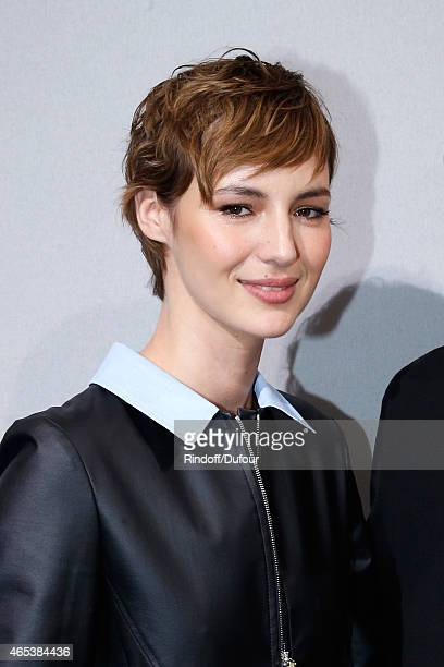 Louise Bourgoin poses backstage after the Christian Dior show as part of the Paris Fashion Week Womenswear Fall/Winter 2015/2016 on March 6, 2015 in...