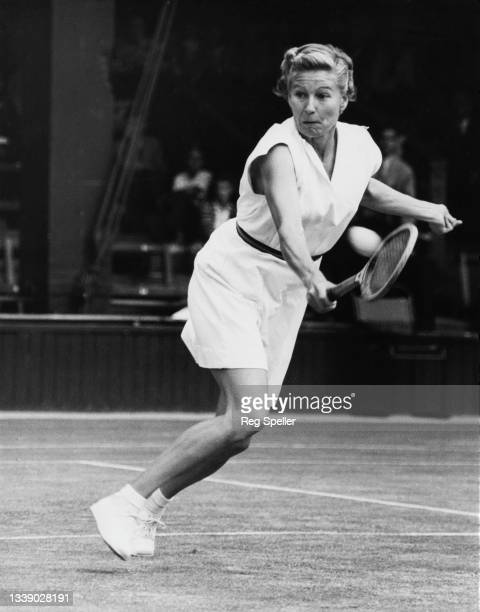 Louise Brough of the United States looks at the tennis ball playing a backhand return to Nelly Landry of France during their Women's Singles Fourth...
