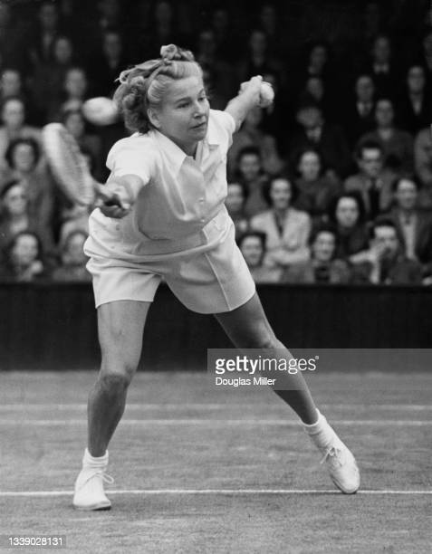Louise Brough of the United States playing a forehand return to Joan Curry of Great Britain during their Women's Singles match of the 18th edition of...