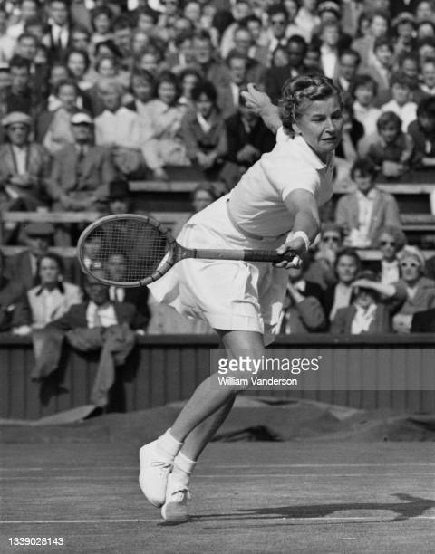 Louise Brough of the United States watches the tennis ball playing a backhand return to compatriot Shirley Fry during their Women's Singles Semi...
