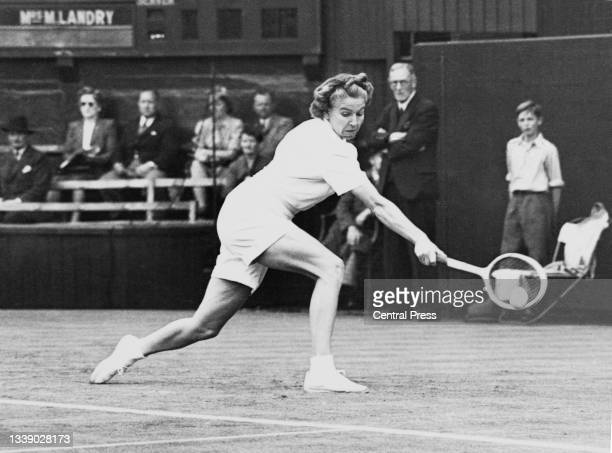 Louise Brough of the United States watches the tennis ball playing a backhand return to Nelly Landry of France during their Women's Singles Second...