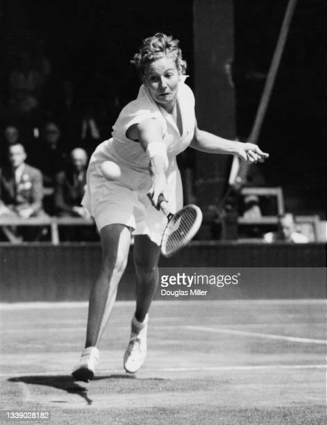 Louise Brough of the United States watches the tennis ball playing a backhand return to Kay Tuckey of Great Britain during their Women's Singles...