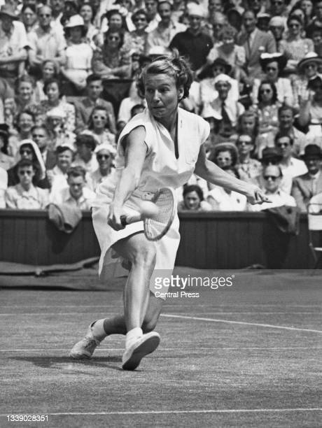 Louise Brough of the United States watches the tennis ball playing a backhand return to compatriot Margaret duPont during their Women's Singles Final...